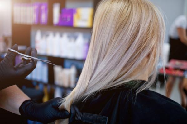 blond woman getting a haircut