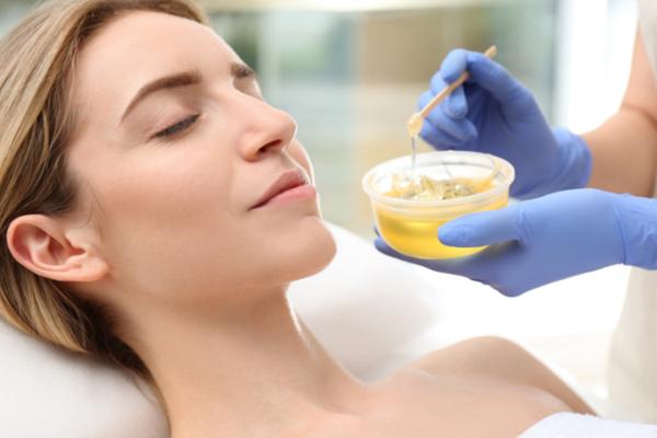 woman getting wax epilation